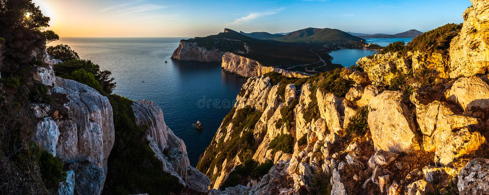 Landscape of the gulf of capo caccia. From the Cave of broken vessels at sunset, alghero, adventure, beach, blue, capocaccia, coast, coastline, grotta, dei stock images