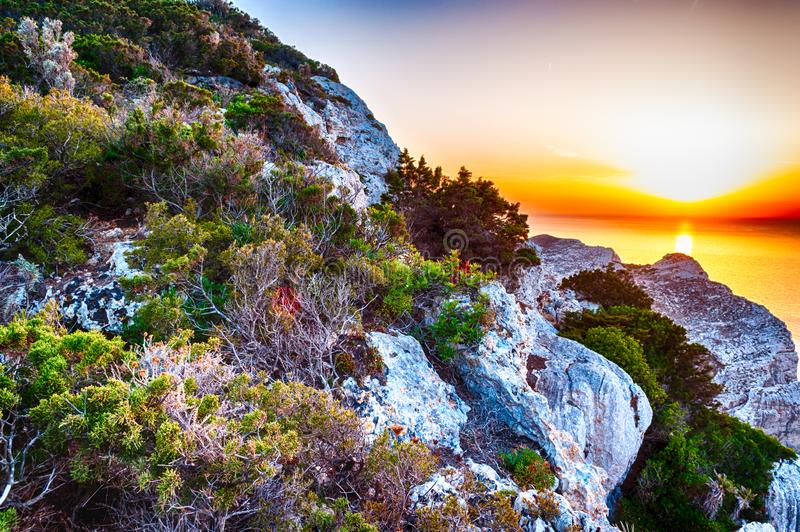 Landscape of the gulf of capo caccia. From the Cave of broken vessels at sunset, alghero, adventure, beach, blue, capocaccia, coast, coastline, grotta, dei stock photo