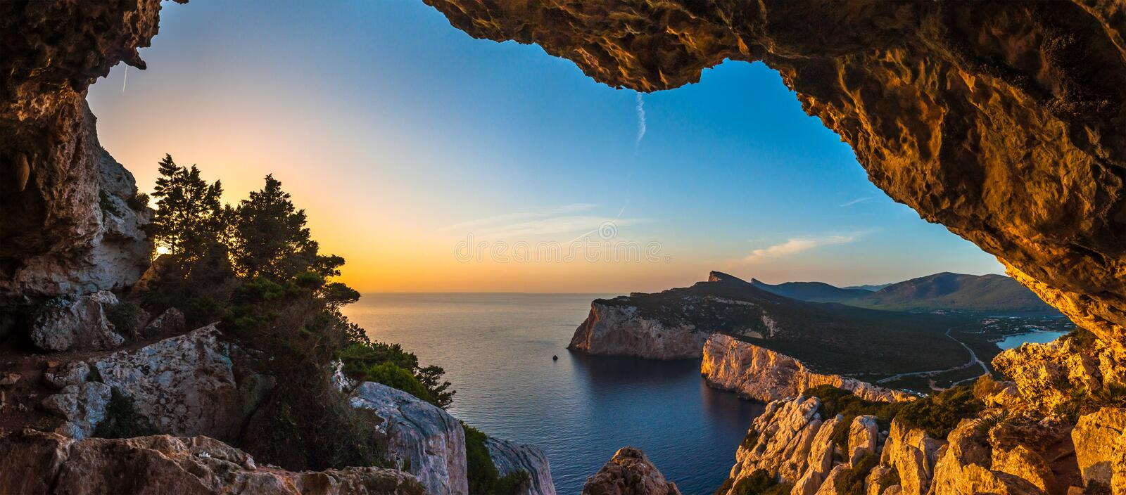 Landscape of the gulf of capo caccia. From the Cave of broken vessels at sunset, alghero, adventure, beach, blue, capocaccia, coast, coastline, grotta, dei stock image