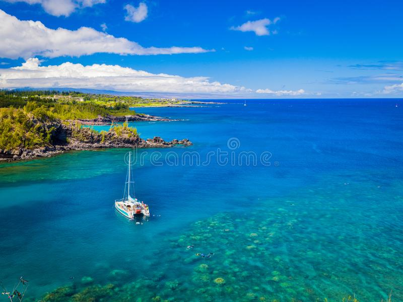 Landscape of Honolua Bay Maui Hawaii Snorkeling coral reefs in marine preserve royalty free stock photos