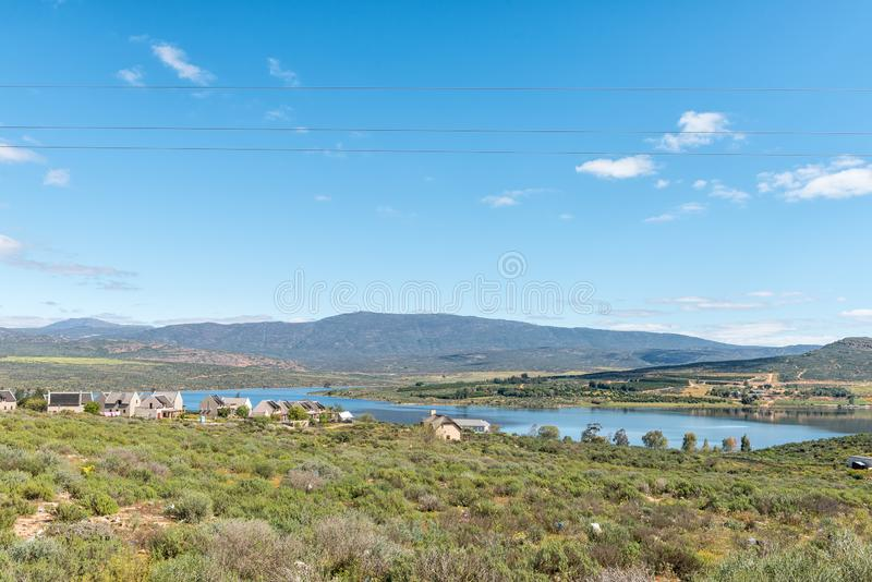 Landscape with houses overlooking the Clanwilliam Dam. CLANWILLIAM, SOUTH AFRICA, AUGUST 22, 2018: A landscape with houses overlooking the Clanwilliam Dam in the stock photos