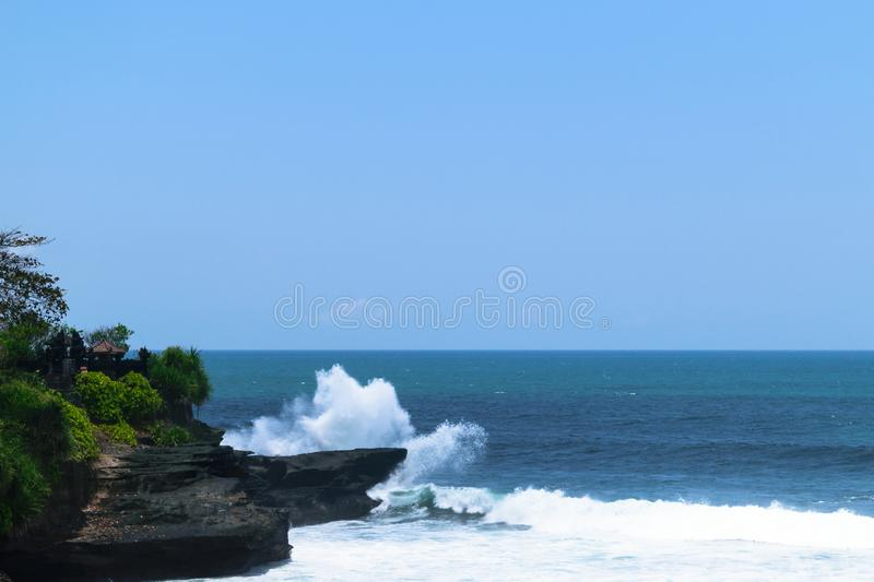 Landscape of huge white Indian ocean wave splash to to the cliff in Bali, Indonesia royalty free stock image