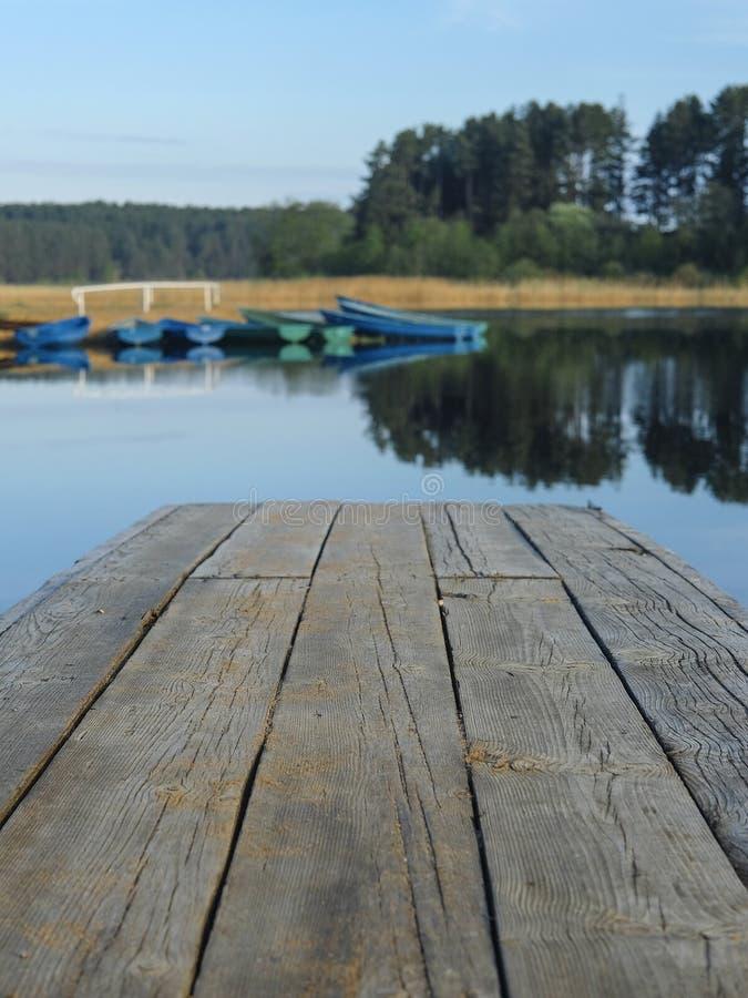Pier on lake Seliger in Svetlitsa village, Russia stock images