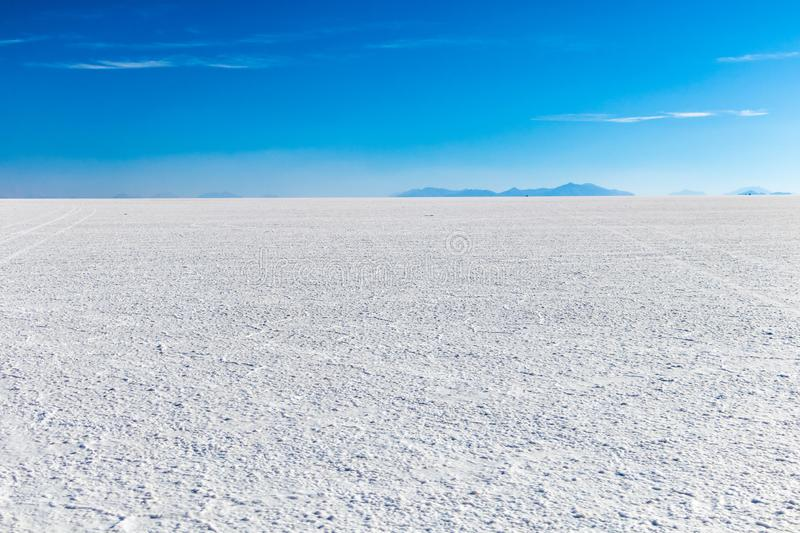 Landscape of incredibly white salt flat Salar de Uyuni, amid the Andes in southwest Bolivia, South America. Landscape of incredibly white salt flat Salar de stock image