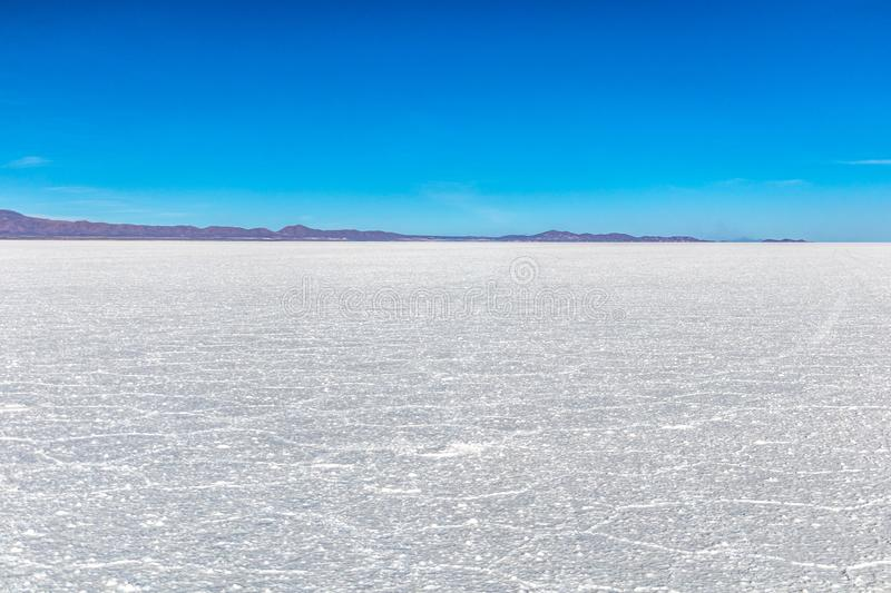 Landscape of incredibly white salt flat Salar de Uyuni, amid the Andes in southwest Bolivia, South America. Landscape of incredibly white salt flat Salar de stock photo