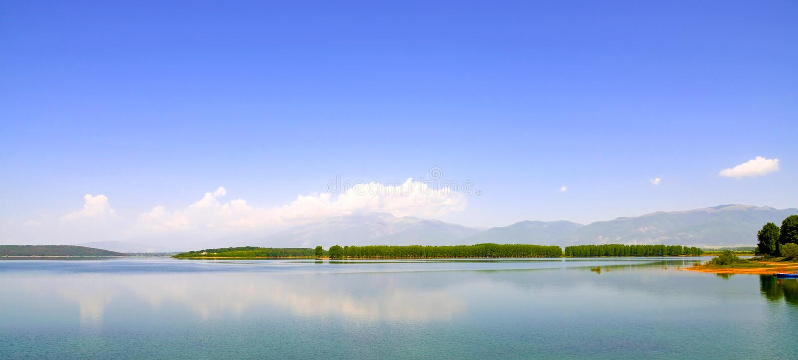 Landscape with the island being reflected in water royalty free stock photo