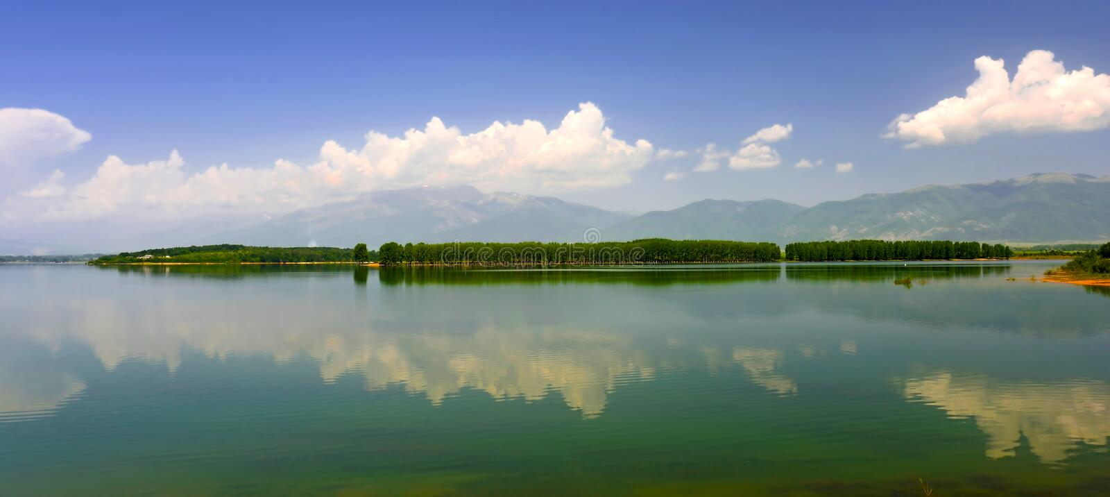 Landscape with the island being reflected in water stock photo