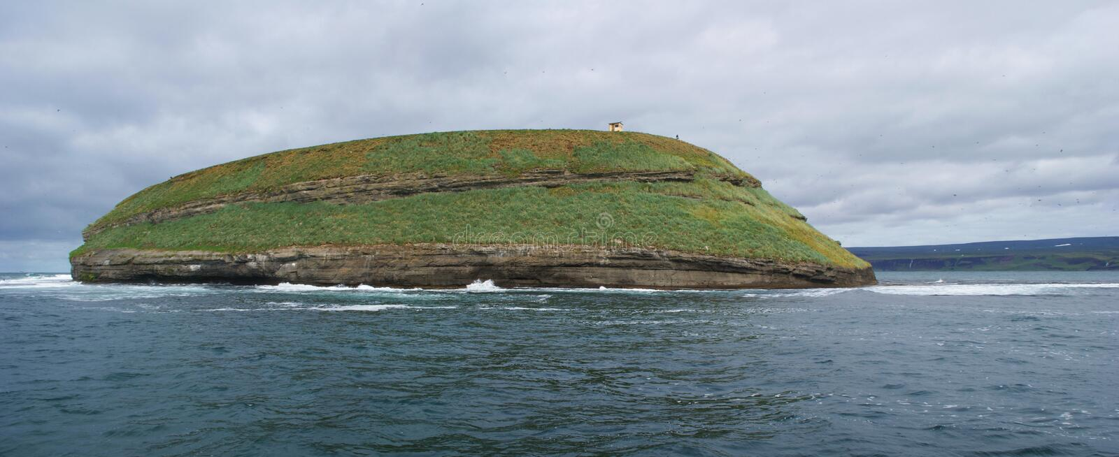 Landscape of the island where the puffins live in Skjalfandi bay in northern Iceland stock photos