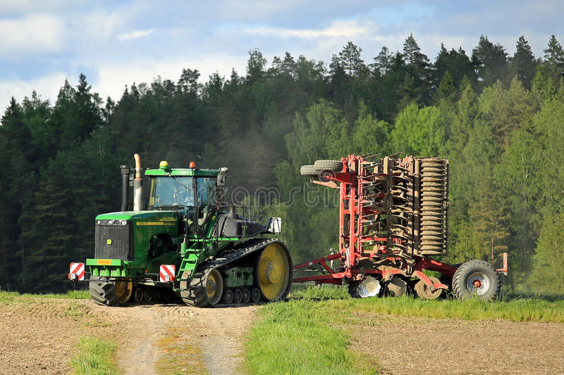 Landscape with John Deere 9520T Crawler Tractor royalty free stock images