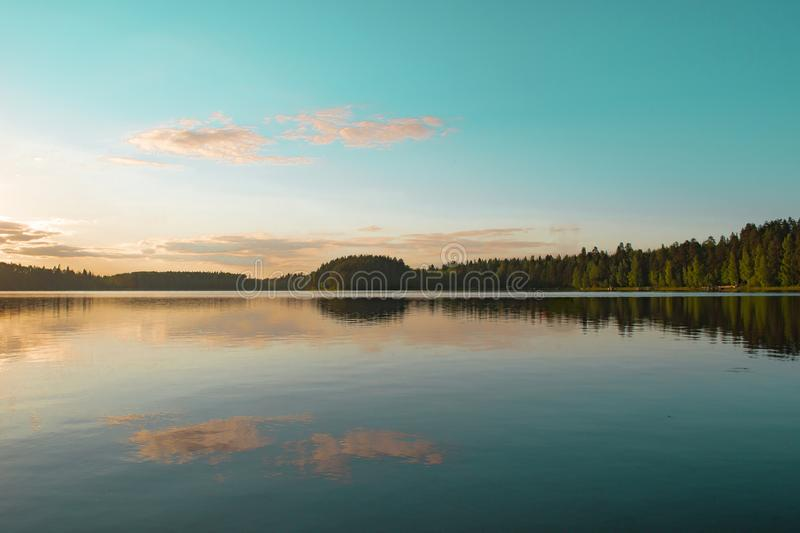 Landscape with lake, blue sky and reflection in the water royalty free stock photo