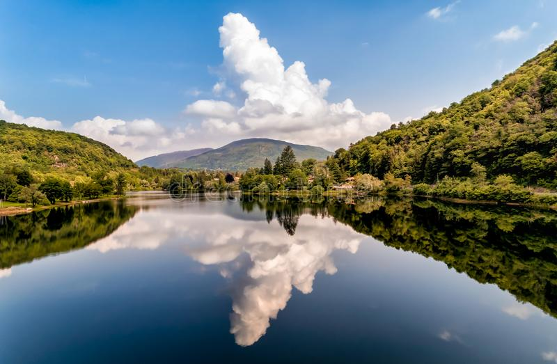 Landscape of the Lake Ghirla with reflections of the clouds, Valganna in Province of Varese. royalty free stock photos