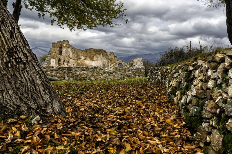 Ruins of a church in Prespes, Greece. Landscape in the lake of Prespes with ruins of an ancient church royalty free stock photography