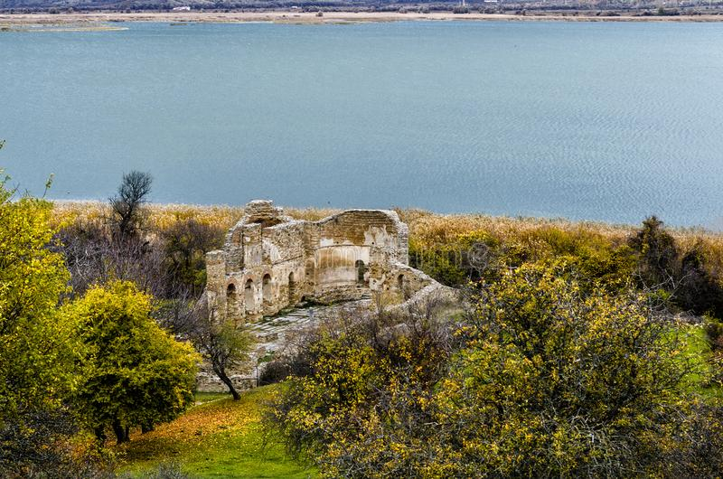 Ruins of a church in Prespes, Greece. Landscape in the lake of Prespes with ruins of an ancient church stock image