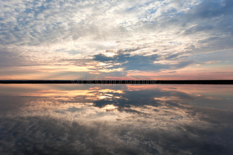 Landscape with lake reflection clouds. Beautiful summer sunset royalty free stock photography