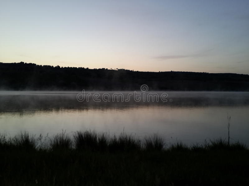 Landscape of a lake. Before sunrise stock images