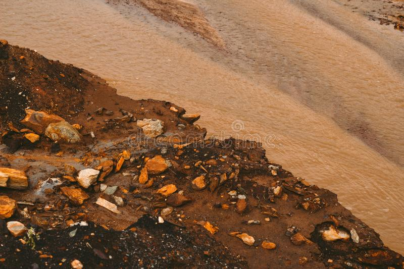 Landscape with red soil polluted copper mining factory in Karabash, Russia, Chelyabinsk region. Landscape with landscape with red water and soil  polluted by royalty free stock images