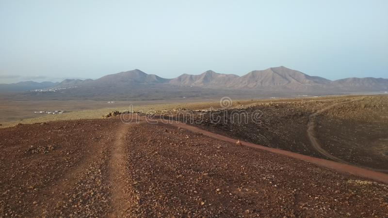 A path to the mountains. The landscape of Lanzarote, a view from Montana Roja royalty free stock images