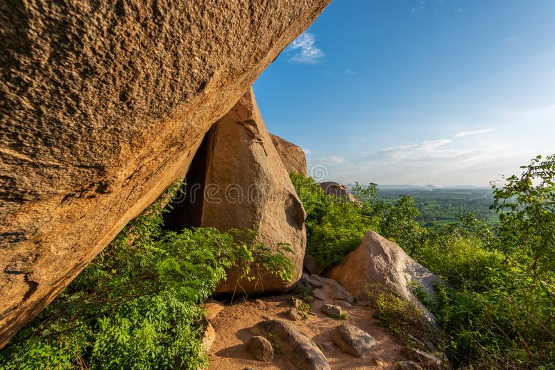 Landscape of large boulders on a hillock against a blue sky royalty free stock photo