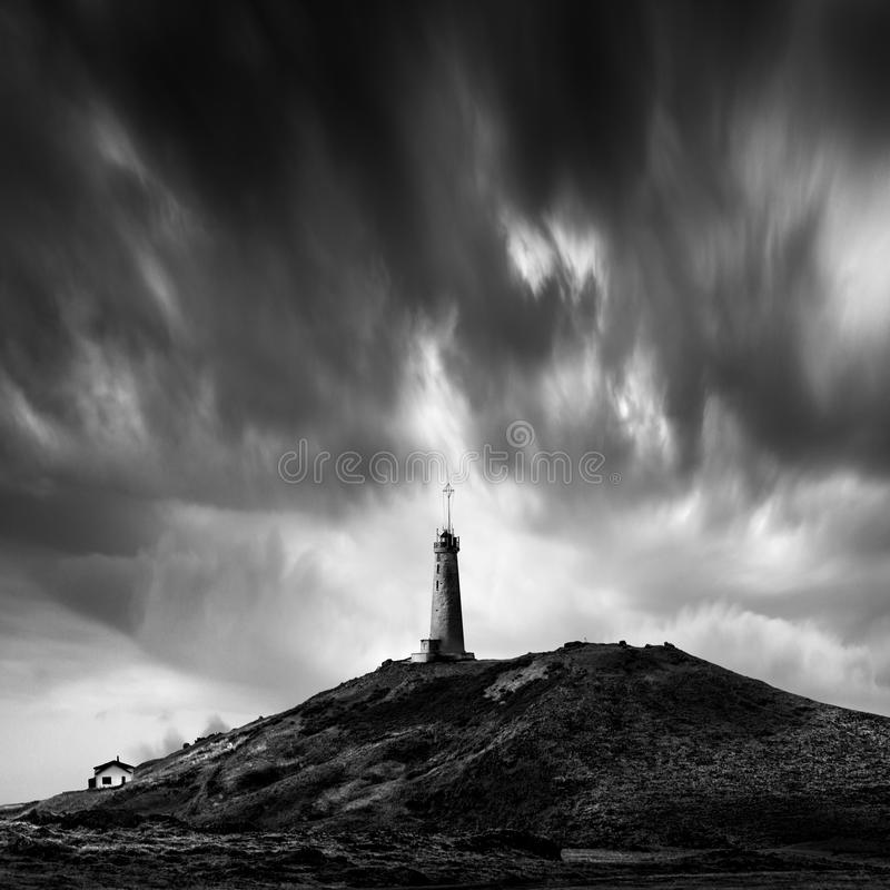 Landscape with lighthouse building stock images