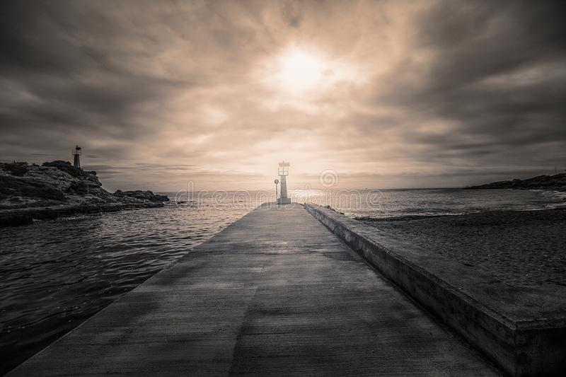 Landscape with a lighthouse stock photos