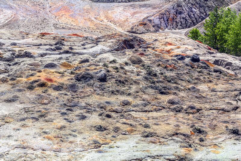 Landscape like a planet Mars surface. Solidified red-brown black Earth surface. Cracked and scorched land. Refractory clay. Quarries. Natural background stock photo