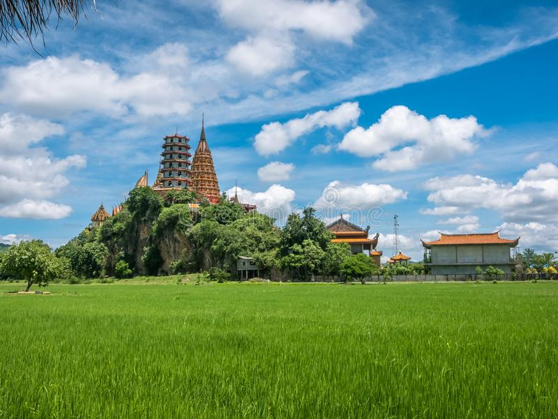 Landscape of lush green rice field and surrounding mountains at Wat Thum Sua temple tiger cave temple. In Kanchanaburi, Thailand stock image