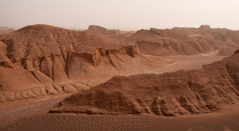 The landscape of Lut Desert or Dasht-e Lut with yardangs, Iran. Lut is the world`s 27th-largest desert, and was inscribed on UNESCO`s World Heritage List on July royalty free stock images