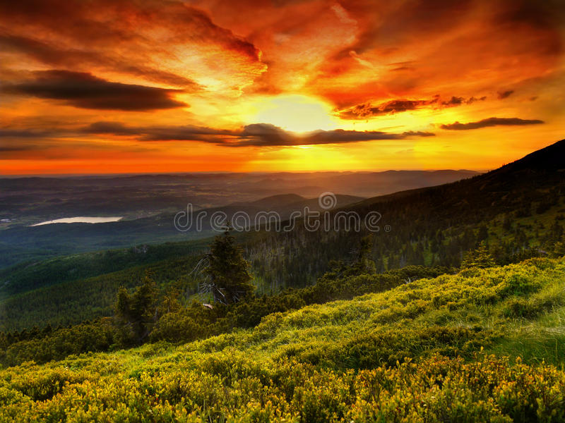 Landscape, Magic colours, Sunrise, Mountain meadow. Landscape - Magic yellow-red colours in sky and yellow-green on mountain meadow after sunrise royalty free stock image