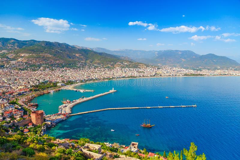 Landscape with marina and Kizil Kule tower in Alanya peninsula, Antalya district, Turkey, Asia. Famous tourist destination with. High mountains. Part of ancient royalty free stock photo