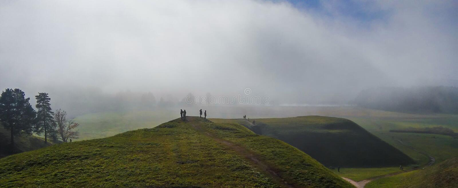 Landscape of the medieval Lithuanian capital Kernave from above with mounds sunken in fog. royalty free stock images