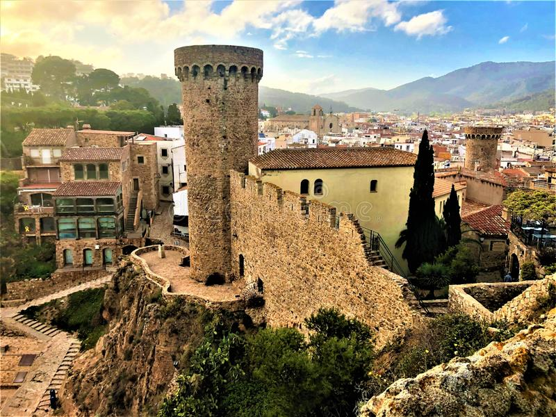 Landscape, medieval tower and wall, sky, trees, roofs in Tossa de Mar, Spain. Landscape, view, medieval tower and wall, balcony, trees, light, fairytale, beauty royalty free stock photos