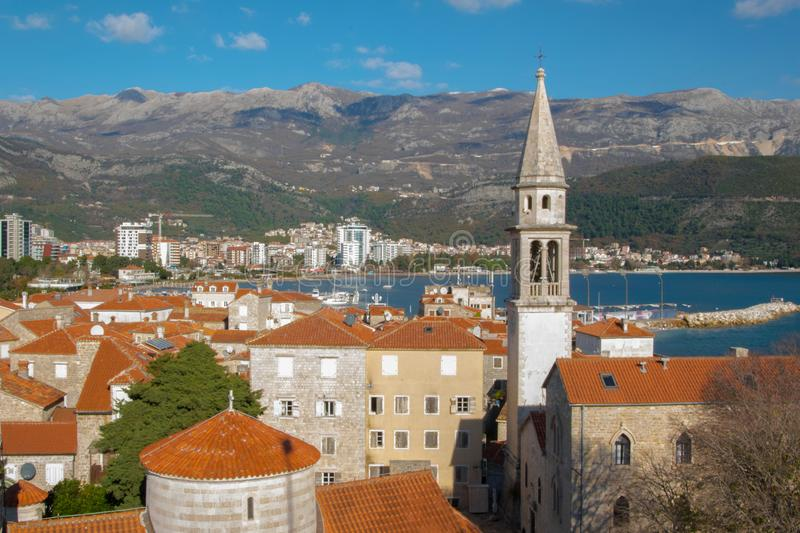 Landscape of of Mediterranean old town Budva, Montenegro. Ancient walls and red tiled roofs royalty free stock images