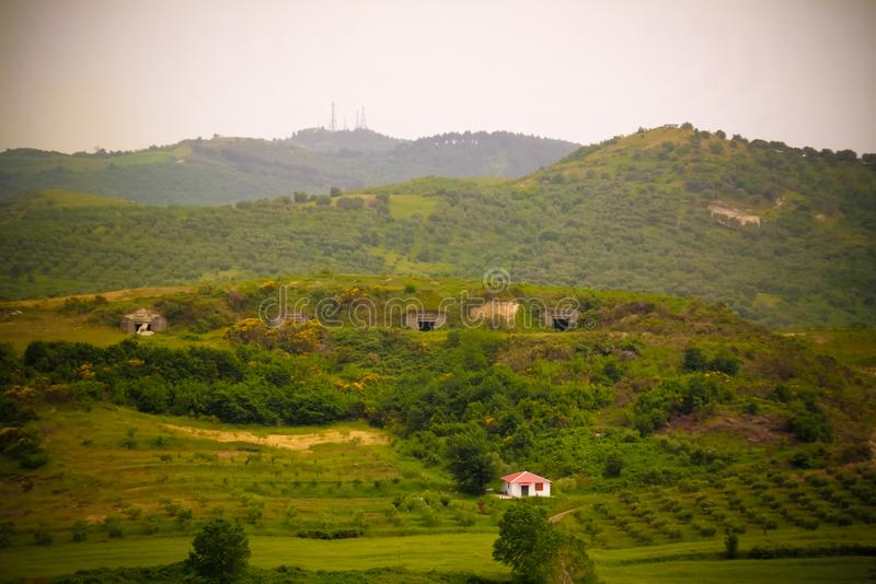 Landscape with the military bunkers in the middle of a rural fields, Apollonia, Fier, Albania. Landscape with the military bunkers in the middle of a rural stock images