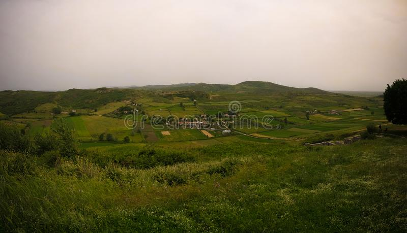 Landscape with the military bunkers in the middle of a rural fields, Apollonia, Fier, Albania. Landscape with the military bunkers in the middle of a rural royalty free stock image