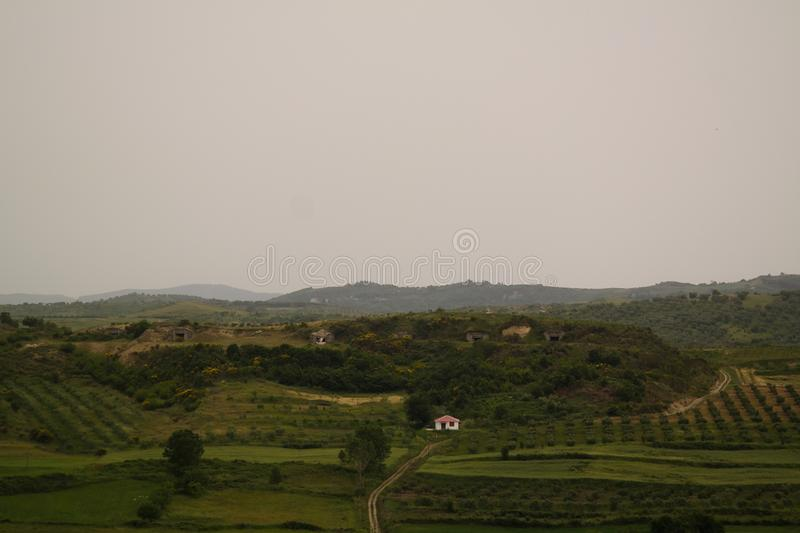 Landscape with the military bunkers in the middle of a rural fields, Apollonia, Fier, Albania. Landscape with the military bunkers in the middle of a rural stock photography