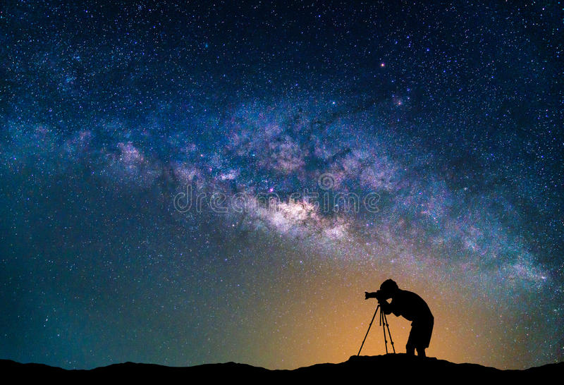 Landscape with Milky way galaxy. Night sky with stars and Photographer take photo on the mountain. stock images