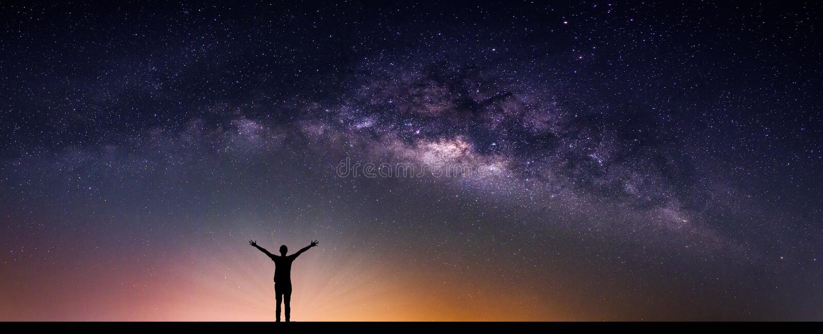 Landscape with Milky way galaxy. Night sky with stars and silhouette happy man on the mountain. Long exposure photograph. stock images