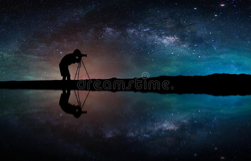 Landscape with Milky way galaxy. Night sky with stars and silhouette Photographer take photo on the mountain. stock images