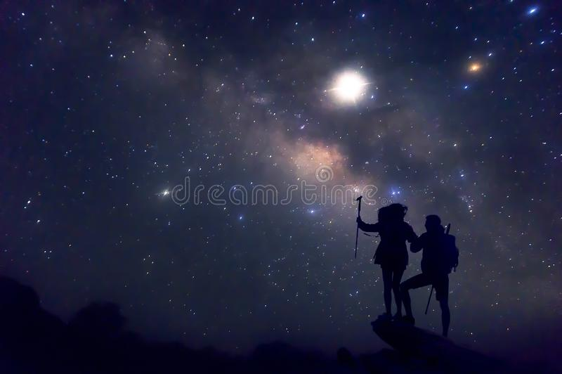 Landscape with Milky Way. Night sky with stars and silhouette of a couples happy stock image