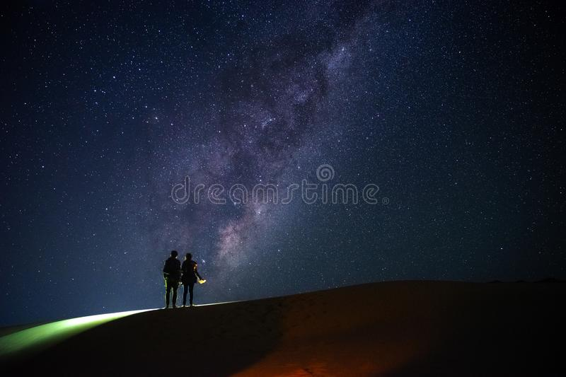 Landscape with Milky Way. Night sky with stars and silhouette of stock images