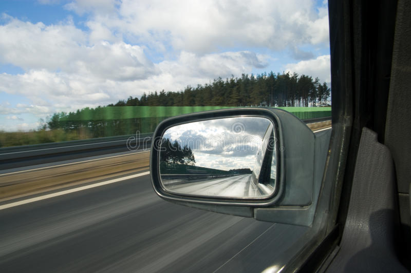 Landscape in the mirror of a car royalty free stock image