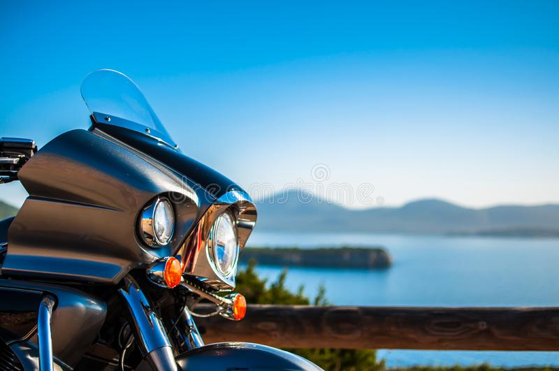 Landscape with a motorcycle on the coast royalty free stock photography