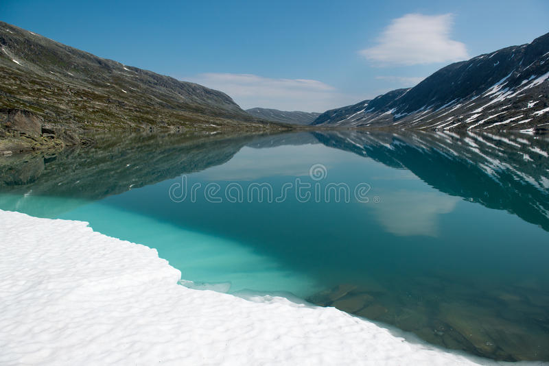 Landscape with mountain lake and snow, Norway stock images