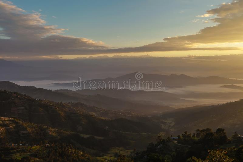Landscape of mountain valley and himalayan range during sunrise,Nepal stock images