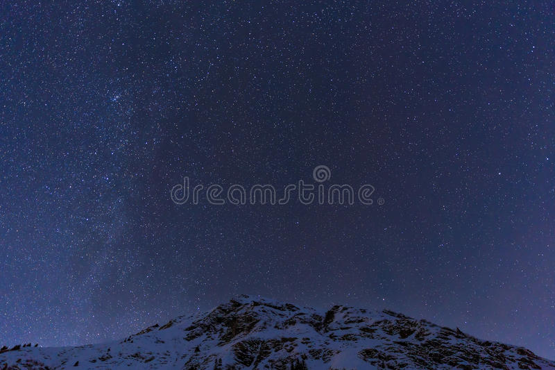 Landscape with mountains and blue sky in winter night royalty free stock photography