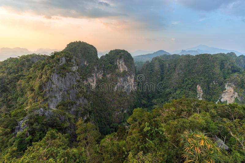 Mountains covered by tropical greenery and trees in asian nature at sunset royalty free stock photo