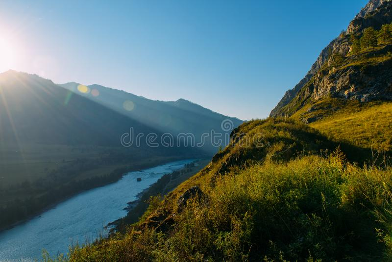 Landscape with mountains, forest and a river in front. beautiful scenery stock photos