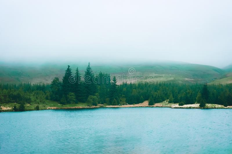 Landscape with mountains and lake during mist Brecon Beacons UK royalty free stock images