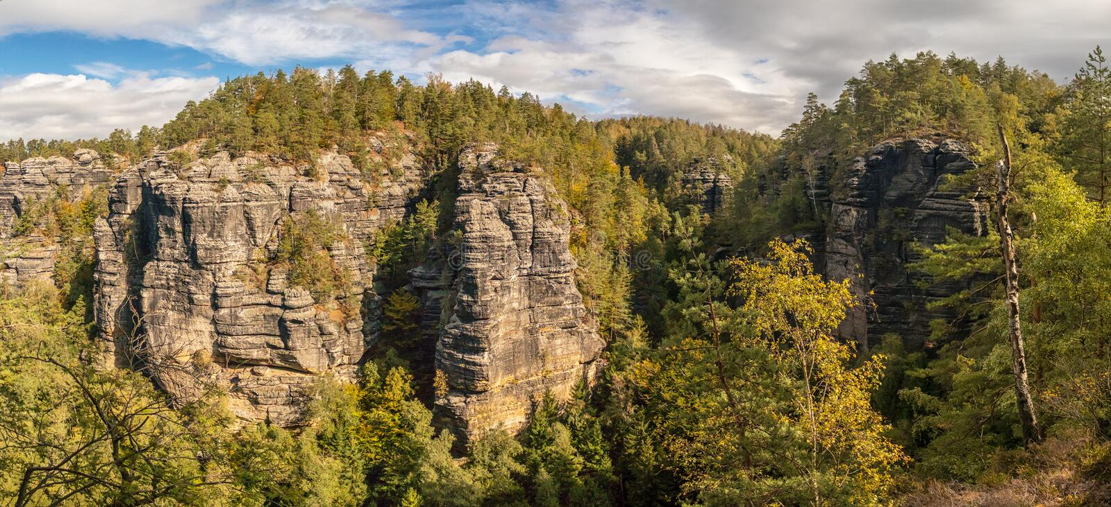 Landscape in mountains - panorama overlooking the valley with forests and sandstone rocks royalty free stock photo