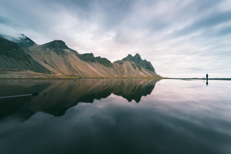Landscape with mountains reflected in water, Iceland. Amazing landscape of mountains reflected in the water the Bay. View of Cape Stokksnes in the southeastern royalty free stock photo